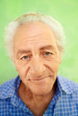 Senior man feelings portrait happy old caucasian man looking camera green background Stock Images
