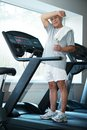 Senior man in a fitness club Royalty Free Stock Photo