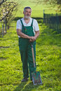 Senior man gardening in his garden Stock Photos
