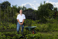 Senior man gardening portrait of happy men in allotment Stock Images