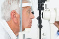 Senior man getting his cornea checked close up side view of a Stock Photo