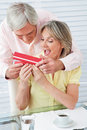 Senior man giving wife a gift Royalty Free Stock Photos