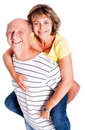 Senior man giving woman piggyback ride Stock Image