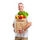 Senior man with a grocery shopping bag isolated on white background Royalty Free Stock Photo