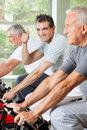 Senior man in gym holding thumbs up Stock Photography