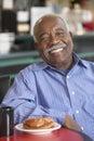 Senior man having morning tea Royalty Free Stock Photo
