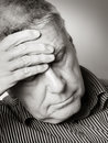 Senior man with a headache photo of Royalty Free Stock Photography