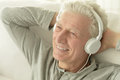 Senior man in headphones Royalty Free Stock Photo