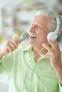 Senior man in headphones singing Royalty Free Stock Photo