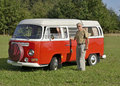 Senior man with his retro car happy beautiful old its a volkswagen bus built in the model is a camping van nice restaurated Stock Images