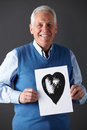 Senior man holding ink drawing of heart Royalty Free Stock Photography