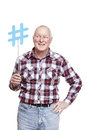 Senior man holding a social media sign smiling Royalty Free Stock Photo