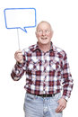 Senior man holding a speech bubble sign smiling Royalty Free Stock Photo