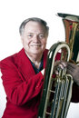 Senior Man holding Tuba on White Royalty Free Stock Images