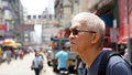 Senior man with hong kong urban architecture scene Royalty Free Stock Photo