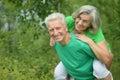 Senior man hugging senior woman in forest