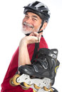 Senior man inline skating Royalty Free Stock Photos