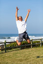 Senior man jumping happy active at the beach Stock Photos