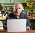 Senior Man with a Laptop Computer Stock Photo