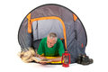 Senior man laying in tent on vacation and reading Royalty Free Stock Image