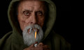 Senior man lights a joint nice image of lighting marijuana Royalty Free Stock Image
