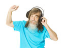 Senior man listening music in headphones. Old man with beard dan Royalty Free Stock Photo