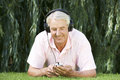 A senior man listening to music Royalty Free Stock Photo