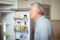Senior man looking in refrigerator Royalty Free Stock Photo
