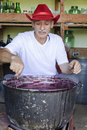Senior man making jam Royalty Free Stock Image