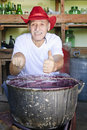 Senior man making jam thumb up Royalty Free Stock Photo