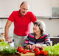 Senior man and mature woman cooking in kitchen men women lunch Royalty Free Stock Photo