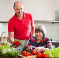 Senior man and mature woman cooking lunch happy men women vegetables Stock Images
