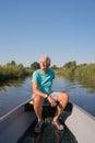 Senior man in motor boat Royalty Free Stock Photo