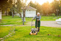 Senior man mowing lawn. Royalty Free Stock Photo