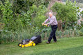 Senior man mowing the lawn. Royalty Free Stock Photo
