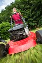 Senior man mowing the lawn Royalty Free Stock Photo