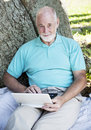 Senior Man with Netbook Royalty Free Stock Photo