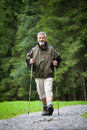 Senior man nordic walking outdoors Stock Photos