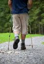 Senior man nordic walking outdoors Stock Images