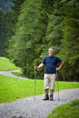 Senior man nordic walking outdoors Royalty Free Stock Photography