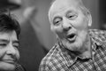 Senior man an older men singing at home Stock Photography