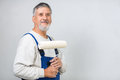Senior man painting a wall in his home Royalty Free Stock Photo