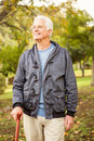 Senior man in the park on an autumns day Royalty Free Stock Photo