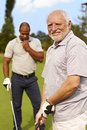 Senior man playing golf happy men golfing smiling Stock Photography