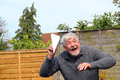 Senior man playing with paper airplane. Royalty Free Stock Photo