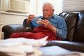 Senior Man With Poor Diet Keeping Warm Under Blanket Royalty Free Stock Photo