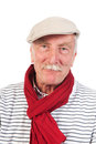 Senior man portrait with cap and scarf Royalty Free Stock Photo