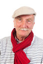 Senior man portrait with cap and scarf Royalty Free Stock Photography