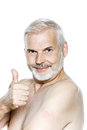 Senior man portrait thumb up nicotine patch one caucasian isolated studio on white background Stock Photo