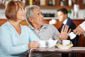 Senior man rejecting coffee in coffee shop men at breakfast a Royalty Free Stock Photography